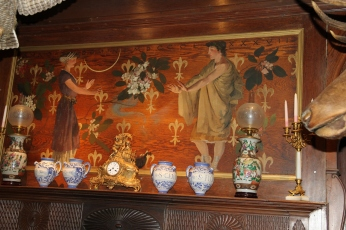 Mounted above the fireplace, this painting, a housewarming present, represents the French and Pennsylvanian connections of the Pinchot Family through the Fleur-de-lis and the Rhododendron.