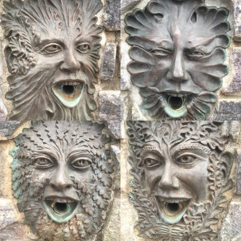 Faces on the Fountain representing the 4 seasons.